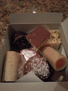 Box of Goodies with Chocolate Badam Barfi on Top Near the back
